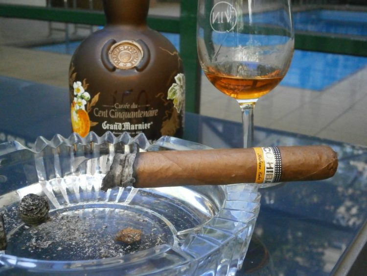 Cohiba Sublimes Extra Colección Habanos 2008, two thirds left, with a bottle of Gran Marnier Cuvee du Cent Cinquantenaire