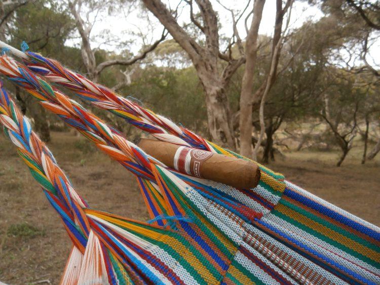 Edmundo Dantes Conde 54 Edición Regional Mexico 2011 half smoked in a hammock