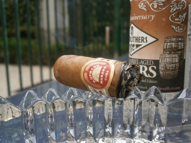 H. Upmann Robustos 520 Aniversario, an inch left, with a Fee Brother's Bitters