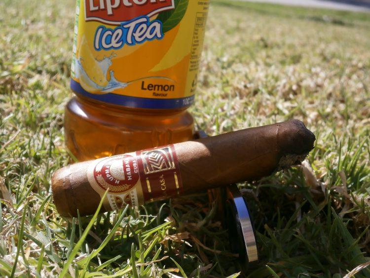 H. Upmann Royal Robusto La Casa del Habano Exclusivo 2011, two thirds left, with a Lipton Ice Tea