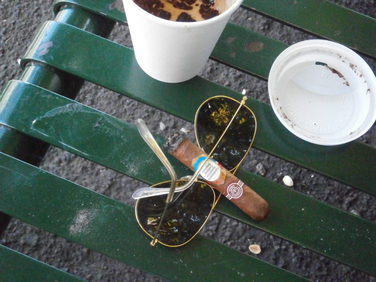 Montecristo B Compay Centennial Humidor, somewhat burnt, with Ray-Ban Aviators and a coffee