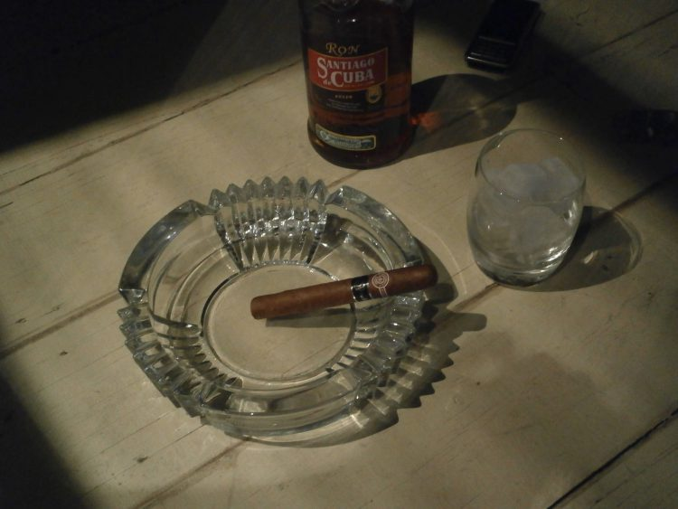 Montecristo No. 4 Reserva Cosecha 2002 unlit with a Havana Club bottle