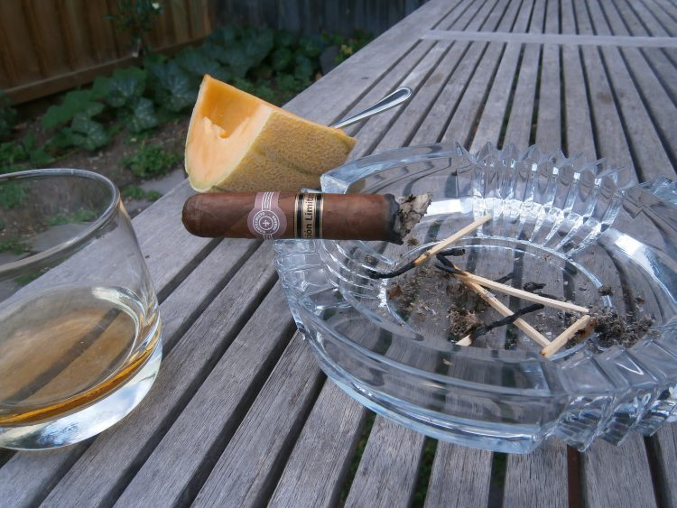 Montecristo Robusto Edición Limitada 2000 partly burnt with a melon