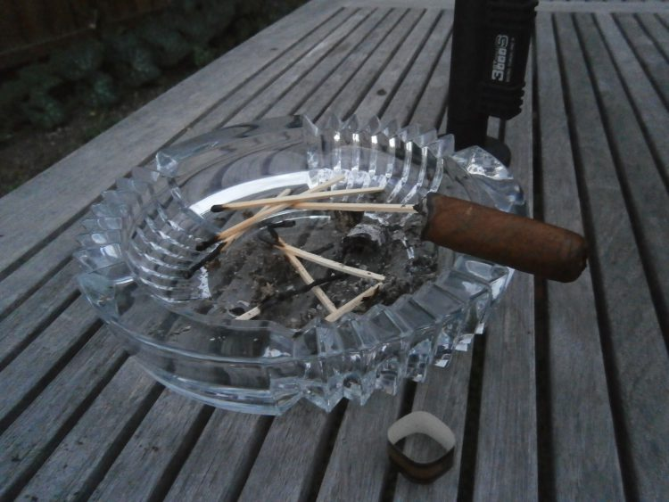 Montecristo Robusto Edición Limitada 2000 half consumed with a lot of spent matches