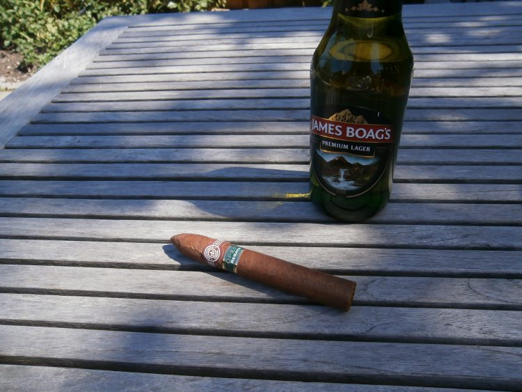 Montecristo Open Regata unlit with a James Boags bottle