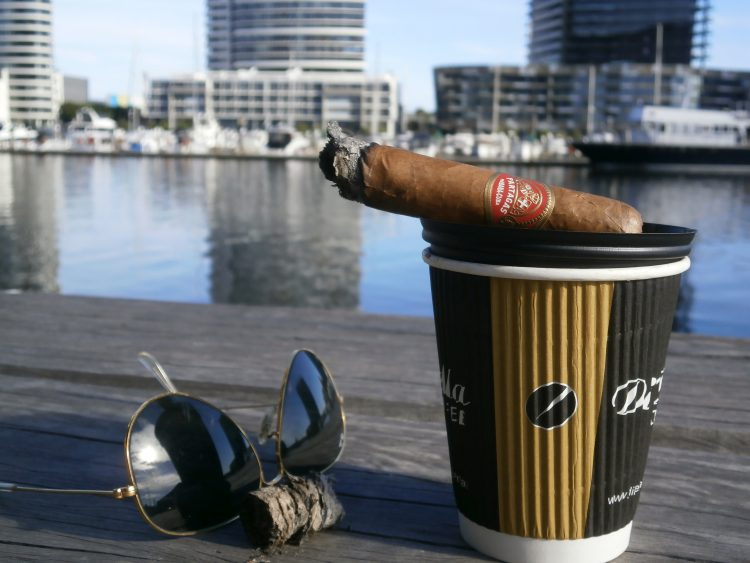 Partagás Sobresalientes Réplica de Humidor Antiguo, two thirds left, with a coffee and some Ray-Ban Aviators