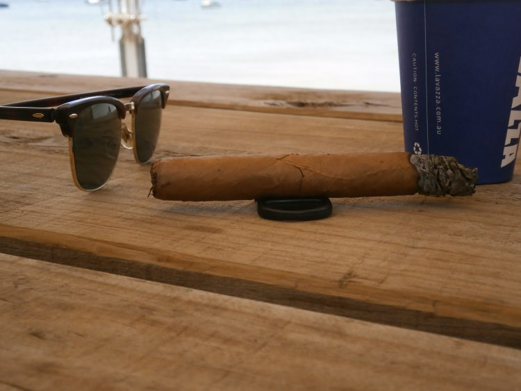 Partagás Serie C No. 1 Colección Habanos 2002 a quarter smoked, with some Ray-Ban Clubmasters