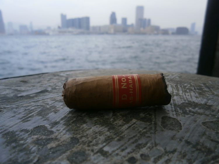 Partagás Serie D No. 4 final third, with Kowloon in the background