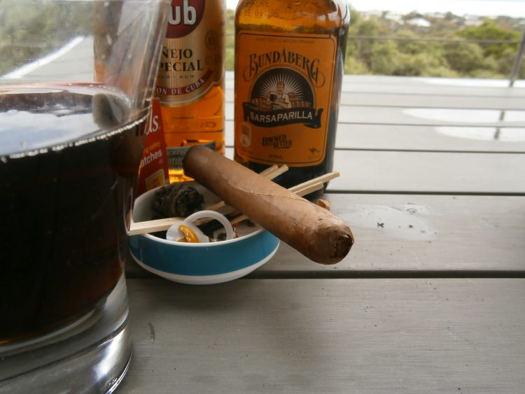 Ranier Custom, three quarters left, with a rum and sarsaparilla