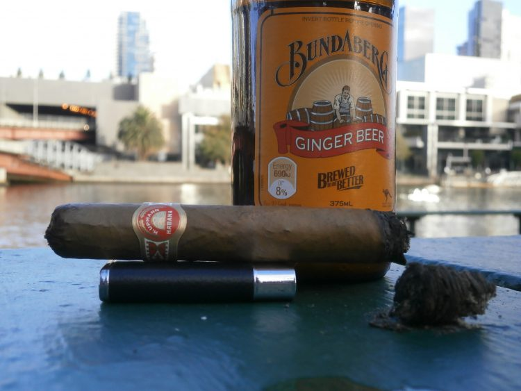 H. Upmann Tacos Imperiales Réplica de Humidor Antiguo 2006, partially smoked, with a bottle of Bundaberg Ginger Beer