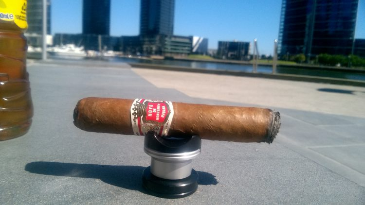 Hoyo de Monterrey Epicure No. 1 in the bright sun, a quarter smoked.